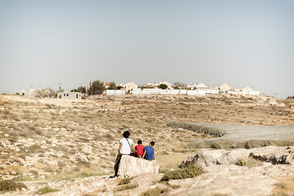 Kids are watching a new settlement grown close to At Tuwani village. (west bank - Palestine)