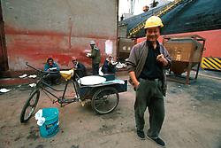 CHINA SHANGHAI NOV01 - Shipyard workers take a lunchbreak on the quay.. . jre/Photo by Jiri Rezac. . © Jiri Rezac 2001. . Contact: +44 (0) 7050 110 417. Mobile:  +44 (0) 7801 337 683. Office:  +44 (0) 20 8968 9635. . Email:   jiri@jirirezac.com. Web:     www.jirirezac.com