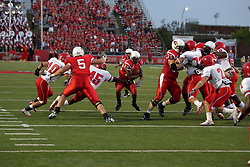 19 September 2009: Geno Blow slashes through the line as Ben Collins gets a paw on him in a game which the Austin Peay Governors were defeated 38-7 by the Illinois State Redbirds at Hancock Stadium on campus of Illinois State University in Normal Illinois