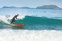 Male surfer riding waves<br /> Whitesands Bay<br /> Near St David's<br /> Pembrokeshire<br /> South<br /> Surfing<br /> Activities and Sports