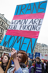 London, UK. 19th January, 2019. Thousands of women take part in the Global Women's March from BBC Broadcasting House to Trafalgar Square to attend a Bread & Roses Rally Against Austerity organised by Women's March London. Inspired by the 1912 Bread & Roses protests which revolutionised workers' rights for women and in the light of Brexit, the organisers called for assurances from the Government in ending policies of austerity which lead to economic oppression, violence against women, the gender pay gap, racism, fascism, institutional sexual harassment and the hostile environment experienced by marginalised groups.