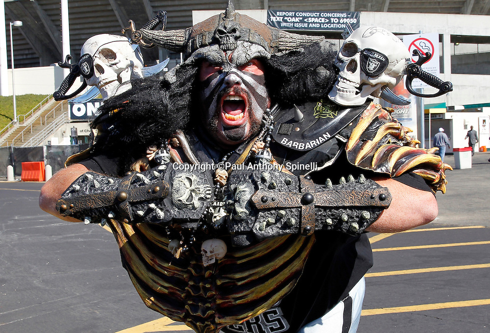 An Oakland Raiders fan in costume cheers for his team while tailgating during the NFL preseason week 3 football game against the San Francisco 49ers on Saturday, August 28, 2010 in Oakland, California. The 49ers won the game 28-24. (©Paul Anthony Spinelli)