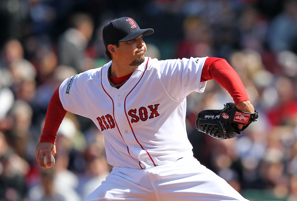 Boston Red Sox starting pitcher Josh Beckett pitches in the third inning against the Tampa Bay Rays at Fenway Park in Boston, Massachusetts, USA on 13 April 2012. The game marks the season home opener for the Red Sox who have won just one game so far this year.