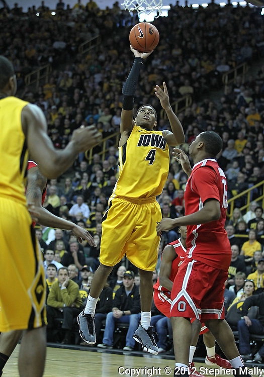 January 07, 2011: Iowa Hawkeyes guard/forward Roy Devyn Marble (4) puts up a shot over Ohio State Buckeyes forward J.D. Weatherspoon (15) during the the NCAA basketball game between the Ohio State Buckeyes and the Iowa Hawkeyes at Carver-Hawkeye Arena in Iowa City, Iowa on Saturday, January 7, 2012.