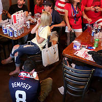 Patrons watch USA v Ghana match of the 2014 World Cup Monday June 16, 2014 at Courts and Sports in Wilmington, N.C. The bar serves as the home of The American Outlaws, the official supporters of the U.S. Men's National Soccer team. (Jason A. Frizzelle)