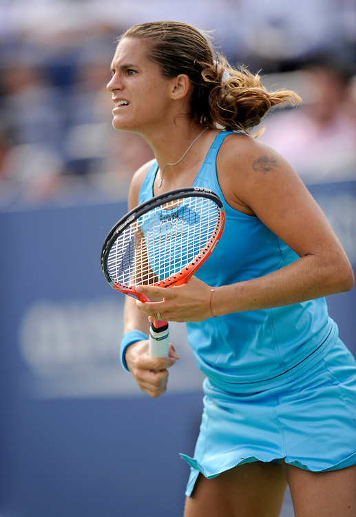 NEW YORK - AUGUST 31: Amelie Mauresmo in action against  Tatjana Malek during day one of the 2009 U.S. Open at the USTA Billie Jean King National Tennis Center on August 31, 2009 in Flushing neighborhood of the Queens borough of New York City. (Photo by Rob Tringali) *** Local Caption *** Amelie Mauresmo