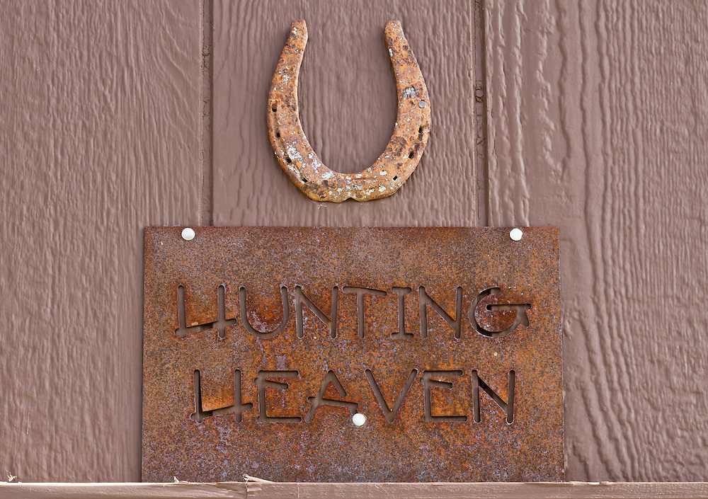 Hunting Heaven sign over doorway of a barn in the country.