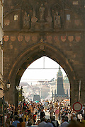 Czeck Republic - Prague, Staré M?sto , Visitors crowd Karlova and continue under the arch of the Old town bridge tower to the Charles bridge.