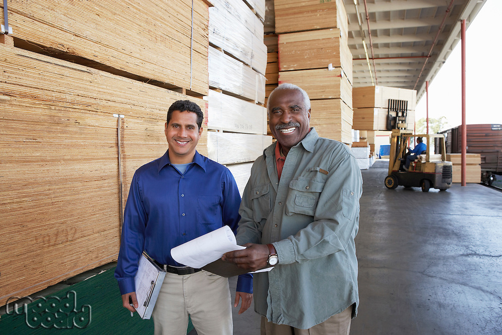 Manager and Worker on Loading Dock of Lumber Warehouse