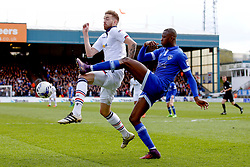 Ousmane Fane of Oldham Athletic clears the ball under pressure from Mark Beevers of Bolton Wanderers - Mandatory by-line: Matt McNulty/JMP - 15/04/2017 - FOOTBALL - Boundary Park - Oldham, England - Oldham Athletic v Bolton Wanderers - Sky Bet League 1