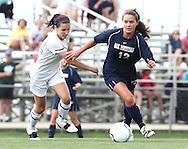 May 12, 2012; Huntsville, AL, USA;  Oak Mountain's Julianne Jackson (12) controls the ball away from Auburn's Rachel Hardgrave (25). Mandatory Credit: Marvin Gentry