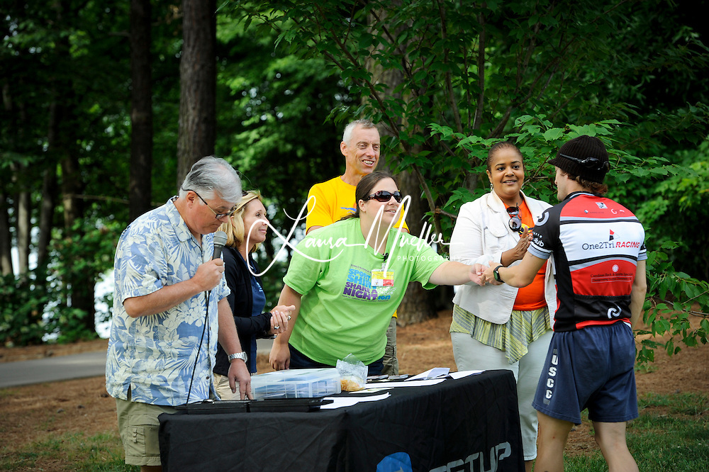 20120512 Jetton Park Triathlon 2012 - This year?s event, scheduled for May 12, includes a 750-meter swim, 20K bike ride, 5K run and a silent auction, to benefit the Ronald McDonald House and the Hope House Foundation of Huntersville. .      New this year is a Corporate Team Challenge in which sponsored employees can earn points toward a Community Award for their company..photo by Laura Mueller.www.lauramuellerphotography.com