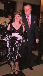 MR & MRS JUSTIN CADBURY at a party in London on 4th March 1998.MFX 15