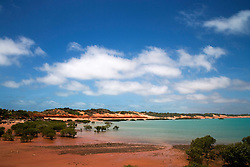 Red pindan soil meets the turquoise water of the Indian ocean near the Broome Port.