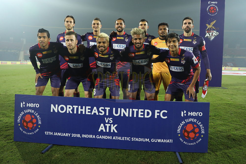 ATK FC players pose for picture for picture during match 45 of the Hero Indian Super League between NorthEast United FC and ATK  held at the Indira Gandhi Athletic Stadium, Guwahati India on the 12th January 2018<br /> <br /> Photo by: Arjun Singh  / ISL / SPORTZPICS