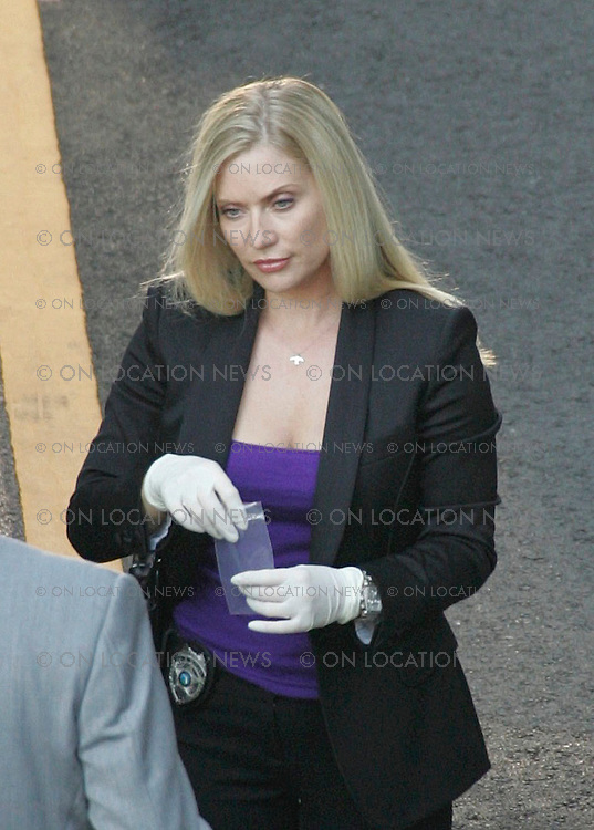 "LOS ANGELES, CALIFORNIA - TUESDAY 15TH JULY 2008 EXCLUSIVE PHOTO Emily Procter, Adam Rodriguez and Rex Linn film scenes for CSI Miami...After a shoot out with the bad guys The CSI's investigate the crime scene. During the filming a green butterfly type bug relentlessly kept flying around actor Adam Rodriguez. After first being irritated by the insect Rodriguez then started to have fun with the bug by dancing and playing with it. After the insect landed on Adam's hand and wrist he walked around the set intoducing his new ""pet"" to all the crew and joked that he was going to take the bug home and that the bug would be his new CSI partner in the show. Photograph: On Location News. Sales: Eric Ford 1/818-613-3955 info@OnLocationNews.com"