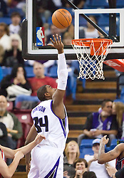 November 27, 2009; Sacramento, CA, USA;  Sacramento Kings forward Jason Thompson (34) shoots against the New Jersey Nets during the first quarter at the ARCO Arena. Sacramento defeated New Jersey 109-96.