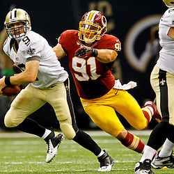 September 9, 2012; New Orleans, LA, USA; Washington Redskins linebacker Ryan Kerrigan (91) chases New Orleans Saints quarterback Drew Brees (9) during the second half of a game at the Mercedes-Benz Superdome. The Redskins defeated the Saints 40-32. Mandatory Credit: Derick E. Hingle-US PRESSWIRE