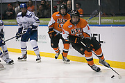 RIT forward Erik Brown skates with the puck during the Atlantic Hockey semifinal against Air Force at the Blue Cross Arena at the War Memorial in Rochester on Friday, March 18, 2016.