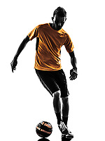 one  young man soccer player orange jersey in silhouette on white background