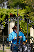 A worker closes a gate at San Gabriel Mission in San Gabriel, Calif., May 14. The first occupants of the mission were the Tonga, also called the Gabrieleño. Today, an active diverse parish celebrates nine Sunday  Masses -- five in English, three in Spanish and one in Vietnamese. © 2015 Nancy Wiechec