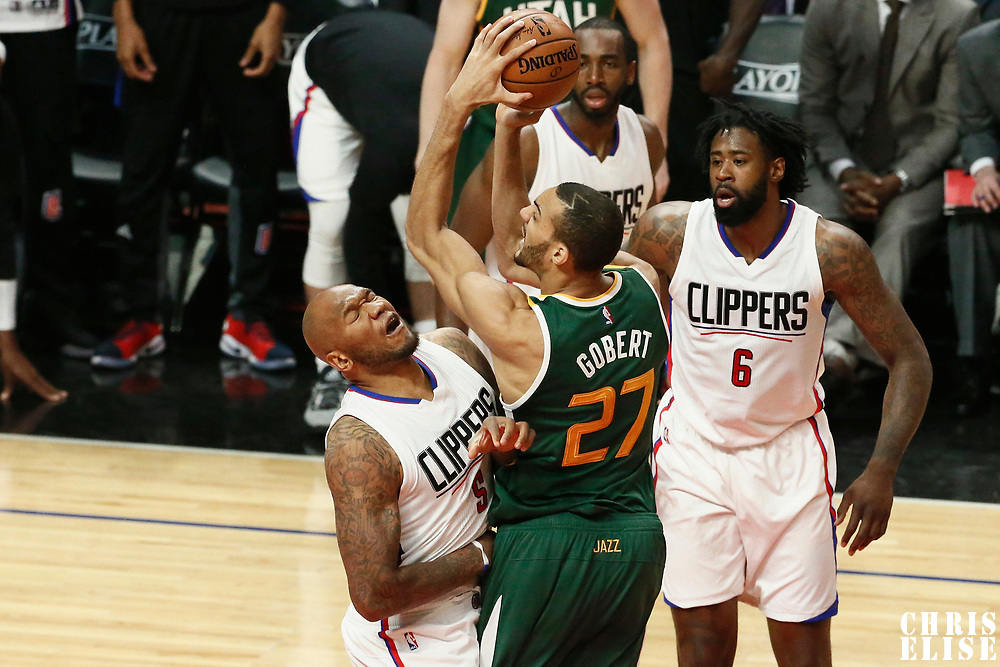 25 April 2017: Utah Jazz center Rudy Gobert (27) takes a jump shot over LA Clippers center Marreese Speights (5) during the Utah Jazz 96-92 victory over the Los Angeles Clippers, during game 5 of the first round of the Western Conference playoffs, at the Staples Center, Los Angeles, California, USA.