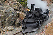 The train crosses the Colorado-New Mexico border 11 times, as it rolls through lonely short grass prairie, remote pine and aspen forests, and climbs around the canyon's of Toltec Gorge and before mounting 10,003-foot Cumbress Pass, the highest point reached by any steam railroad in North America.