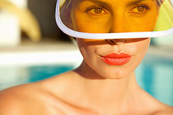 Woman with Red Lips Wearing Yellow Visor