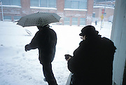 two people walking in to a snow storm