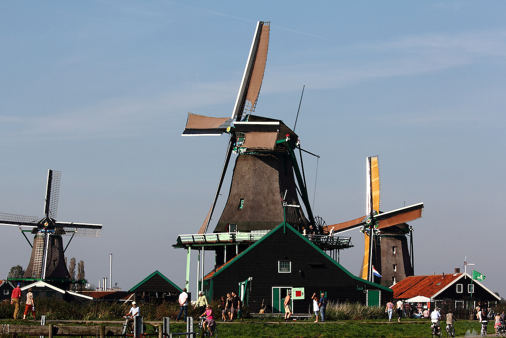 Windmill Trio at Zaanse Schans, just north of Amsterdam, with visitors buzzing around enjoying the hot & unusual early October weather