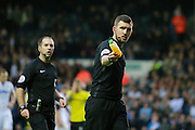 Projectiles thrown at the lines-man before Leeds United's penalty during the EFL Sky Bet Championship match between Leeds United and Burton Albion at Elland Road, Leeds, England on 29 October 2016. Photo by Richard Holmes.