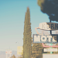 A retro motel sign for a long abandoned motel in California