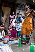 Anita Suresh Kasbe,  41, the Unicef community facilitator is teaching the girls attending the Unicef-run 'Deepshikha Prerika' project inside the Milind Nagar Pipeline Area, an urban slum on the outskirts of Mumbai, Maharashtra, India.