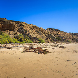 Photo of Crystal Cove State Park cliffs. Crystal Cove is located along the Pacific Ocean in Laguna Beach and Newport Beach in Southern California. Image Copyright © Paul Velgos All Rights Reserved.