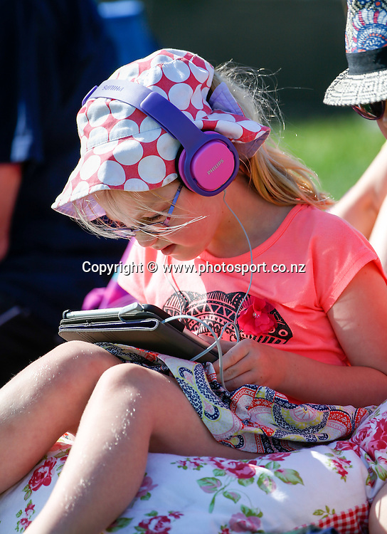 Fans make the most of the sun. First day, ANZ Boxing Day Cricket Test, New Zealand Black Caps v Sri Lanka, 26 December 2014, Hagley Oval, Christchurch, New Zealand. Photo: John Cowpland / photosport.co.nz