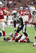 San Diego Chargers outside linebacker Melvin Ingram (54) stands over Arizona Cardinals quarterback Drew Stanton (5) after sacking him during the 2015 NFL preseason football game against the Arizona Cardinals on Saturday, Aug. 22, 2015 in Glendale, Ariz. The Chargers won the game 22-19. (©Paul Anthony Spinelli)
