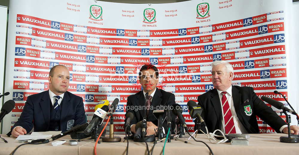 CARDIFF, WALES - Thursday, January 19, 2012: Wales' new national team manager Chris Coleman during a press conference to announce his appointment at the St. David's Hotel. Also Chief-Executive Jonathan Ford (L) and President Phil Pritchard. (Pic by David Rawcliffe/Propaganda)