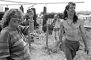 'Flower ladies' growing flowers and other plants in a small garden at Glastonbury, 1989.