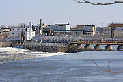At De Pere, Wisconsin, the US Army Corps of Engineers maintains a low-head dam on the Fox River to maintain river levels upstream. In the spring of 2008, a very rainy spell turned the lower Fox River into a raging torrent. This image captures the dam, somewhat after the maximum flow had subsided.