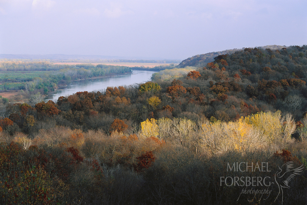 Trees line the shores and surrounding bluffs of the Missouri River.  Indian Cave State Park, Nebraska.