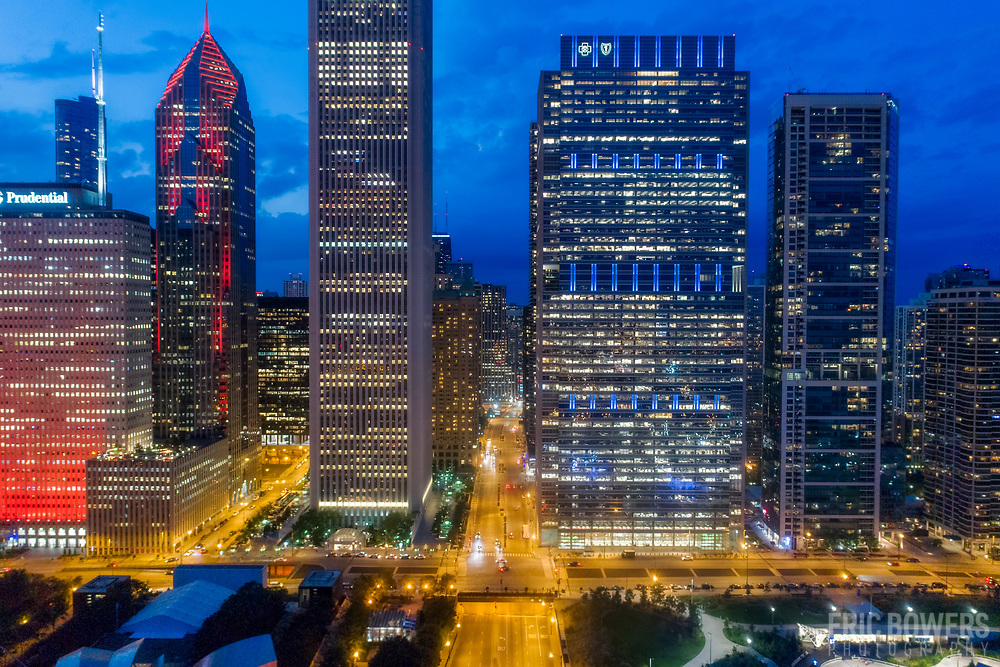 Chicago skyscrapers, high angle aerial view at dusk; Prudential, Aon, Blue Cross Blue Shield Towers on northern edge of Millenium Park.