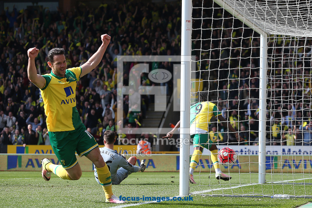 Dieumerci Mbokani of Norwich puts the ball in the net but it's ruled out for offside by Assistant Referee Daniel Cook during the Barclays Premier League match at Carrow Road, Norwich<br /> Picture by Paul Chesterton/Focus Images Ltd +44 7904 640267<br /> 02/04/2016