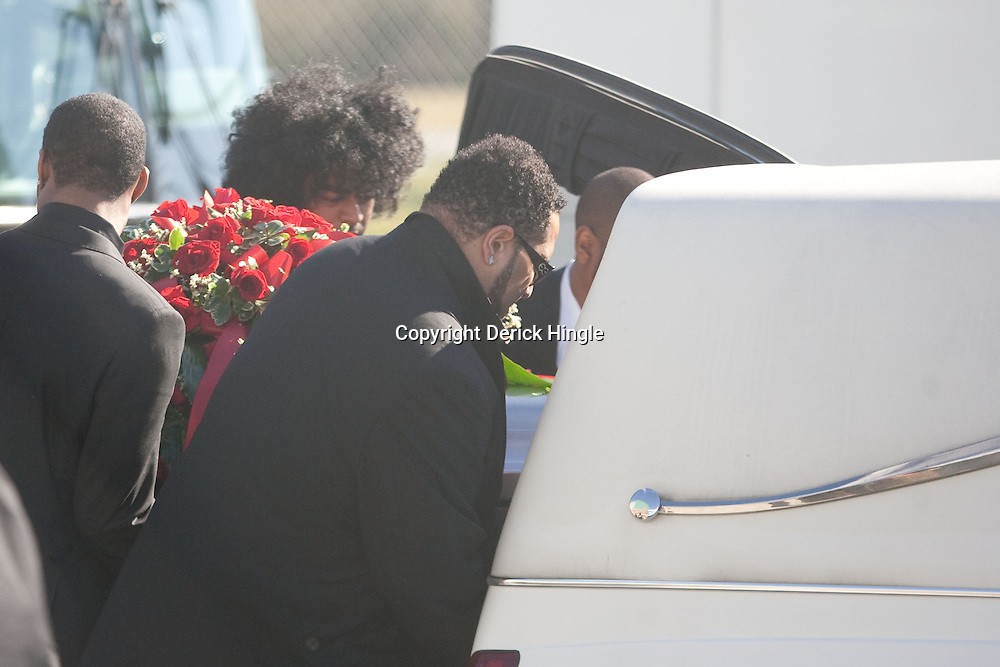 Dec 22, 2009; Westwego, LA, USA;  Family members load the casket into the hearse following funeral services for Cincinnati Bengals wide receiver Chris Henry held at the Alario Center. Mandatory Credit: Derick E. Hingle-US PRESSWIRE