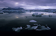 Jokulsarlon Lagoon is a unique sight in Iceland. It is full of small icebergs that are really blocks of ice falling from the calving Breidamerkurjokull glacier.