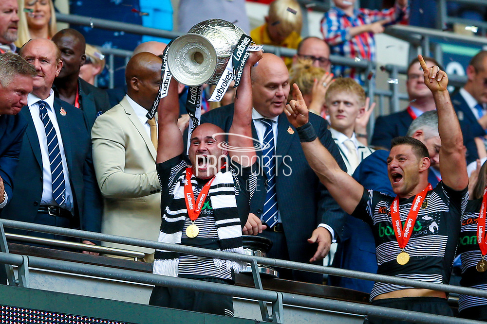 Hull FC hooker Danny Houghton (9)  lifts the challenge cup for the victorious Hull FC side during the Ladbrokes Challenge Cup Final 2017 match between Hull RFC and Wigan Warriors at Wembley Stadium, London, England on 26 August 2017. Photo by Simon Davies.