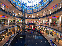 Large atrium with pool for testing canoes and kayaks in Globetrotter sports shop in Cologne Germany