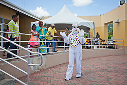 The Easter Bunny takes a stroll before the Easter Bonnet Parade.  Easter Sunday Extravaganza at Crown Bay Center.  St. Thomas, VI.  5 April 2015.  © Aisha-Zakiya Boyd