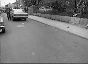 Scene Of Garda Shooting In North Strand.  (N78)..1981..26.05.1981..05.26.1981..26th May 1981..After a shootout in North Strand, Dublin, a Special Task Force Detective was shot and wounded. Word from The Richmond Hospital was that the detective was lucky to be alive as the bullet had narrowly missed a vital artery. He is said to be recovering after surgery...Image shows the scene of the shooting in North Strand. The Garda's blood is seen spilt on the foothpath and roadway.