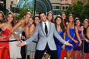 Actor and dancer Gilles Marini poses with the Indy 500 Princesses at the Regions Bank Snakepit Ball in Indianapolis.