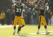 November 23 2013: Iowa Hawkeyes defensive back John Lowdermilk (37) and Iowa Hawkeyes defensive back B.J. Lowery (19) react to a pass interference call on a pass intended for Michigan Wolverines wide receiver Jeremy Gallon (21) during the first quarter of the NCAA football game between the Michigan Wolverines and the Iowa Hawkeyes at Kinnick Stadium in Iowa City, Iowa on November 23, 2013. Iowa defeated Michigan 24-21.